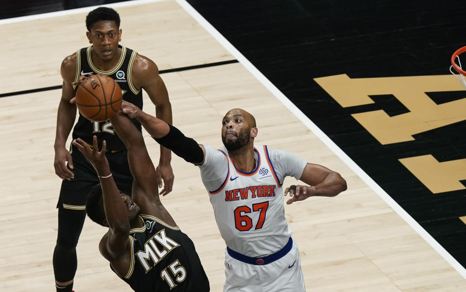 New York Knicks' Taj Gibson (67) blocks Atlanta Hawks' Clint Capela (15) from shooting during the first half in Game 4 of an NBA basketball first-round playoff series Sunday, May 30, 2021, in Atlanta. (AP Photo/Brynn Anderson)