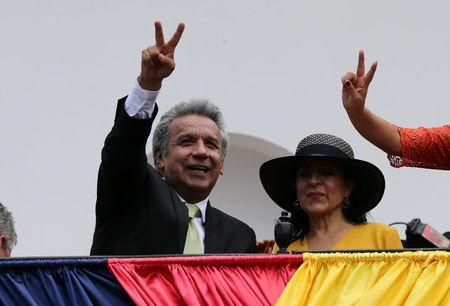 Ecuador's Presidential candidate Lenin Moreno stands next to his wife Rocio Gonzalez as he greets supporters from the government palace's balcony during a military change of guard ceremony in Quito
