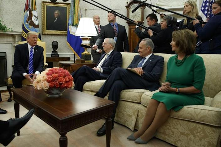 President Donald Trump speaks to, from left, Senate Majority Leader Mitch McConnell, R-Ky., Senate Minority Leader Chuck Schumer, D-N.Y., and House Minority Leader Nancy Pelosi, D-Calif., during a meeting with Congressional leaders in the Oval Office of the White House, Wednesday, Sept. 6, 2017, in Washington. (AP Photo/Evan Vucci)
