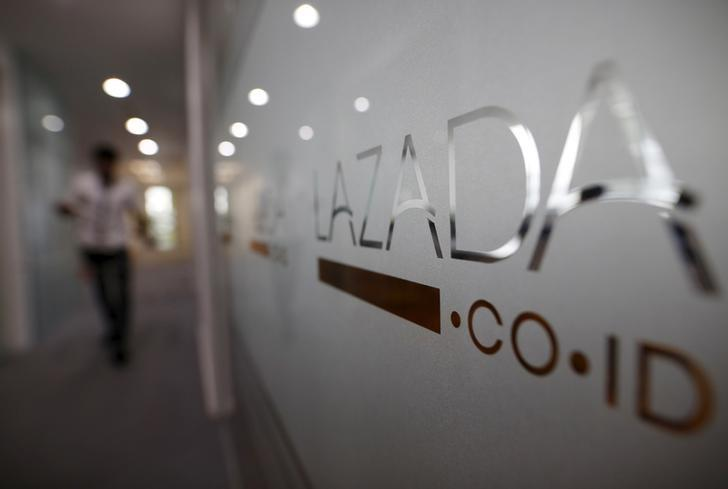 An employee at online retailer Lazada walks into the company's office in Jakarta