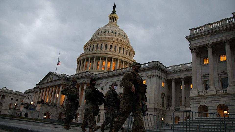 Members of the U.S. National Guard walk outside the U.S. Capitol in Washington, D.C. on Sunday, Jan. 1
