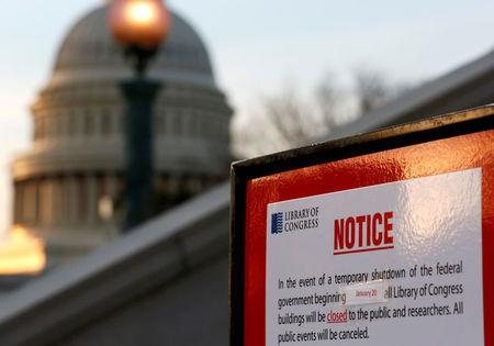 A sign announces the closure of the Library of Congress after President Donald Trump and the U.S. Congress failed to reach a deal on funding for federal agencies in Washington, U.S., January 20, 2018. REUTERS/Joshua Roberts