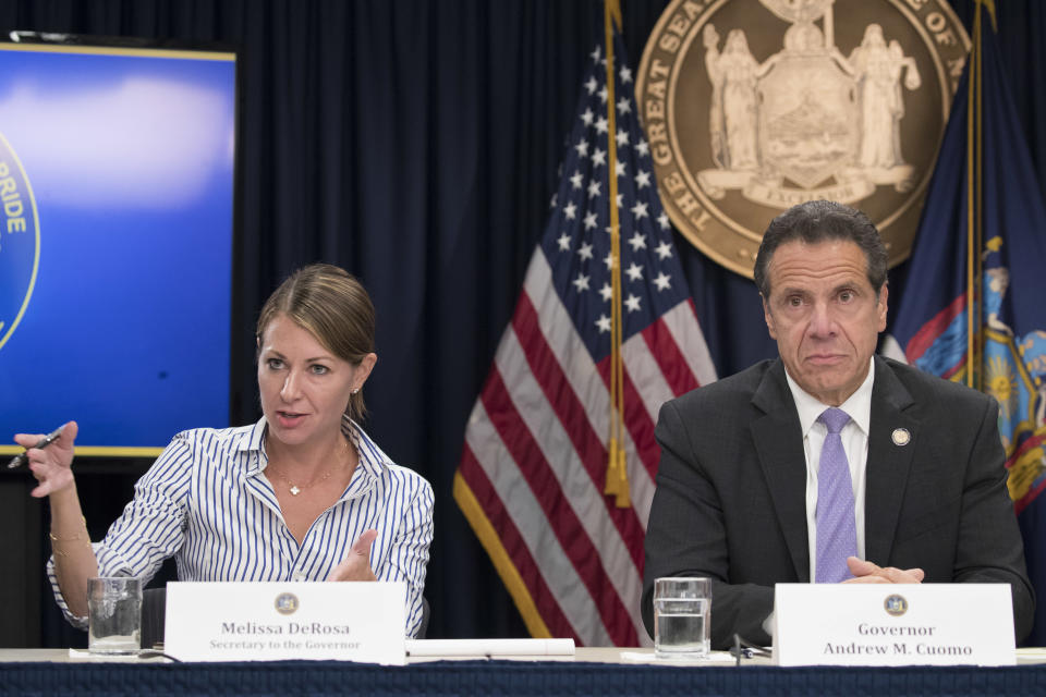 """FILE — In this Sept. 14, 2018 file photo, Secretary to the Governor Melissa DeRosa, is joined by New York Gov. Andrew Cuomo as she speaks to reporters during a news conference, in New York. De Rosa, Cuomo's top aide, told top Democrats frustrated with the administration's long-delayed release of data about nursing home deaths that the administration """"froze"""" over worries about what information was """"going to be used against us,"""" according to a Democratic lawmaker who attended the Wednesday, Feb. 10, 2021 meeting and a partial transcript provided by the governor's office. (AP Photo/Mary Altaffer, File)"""