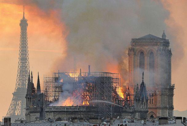 PHOTO: Flames and smoke rise from the blaze after the spire toppled over on Notre Dame cathedral in Paris, April 15, 2019. (Thierry Mallet/AP)