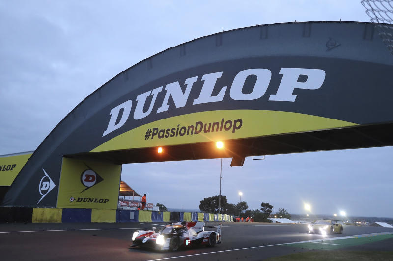 The Toyota TS050 Hybrid No8 of the Toyota Gazoo Racing Team driven by Sebastien Buemi of Switzerland, Kazuki Nakajima of Japan and Fernando Alonso of Spain races early morning during the 87th 24-hour Le Mans endurance race, in Le Mans, western France, Sunday, June 16, 2019. (AP Photo/David Vincent)