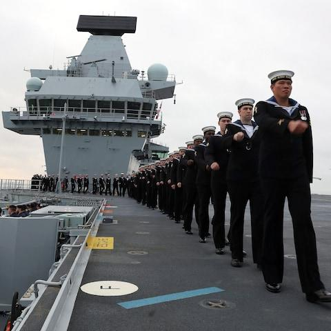 crew on the deck of HMS Queen Elizabeth, the UK's newest aircraft carrier, as the ship arrives in Portsmouth - Credit: Ray Jonesn/Royal Navy/PA