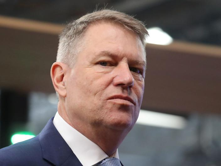 FILE PHOTO: Romania's President Klaus Werner Iohannis arrives for the second day of a special European Council summit in Brussels, Belgium February 21, 2020. Ludovic Marin/Pool via REUTERS/File Photo