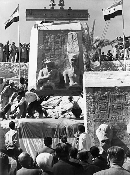 In 1966, the first relocated blocks of the Abu Simbel temple complex are installed in their new site 64 metres (210 feet) above their original location now submerged by the dammed river