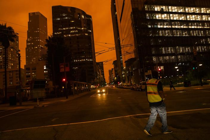 "An orange glow is seen over a darkened Howard Street in San Francisco. <span class=""copyright"">(Philip Pacheco / Getty Images)</span>"