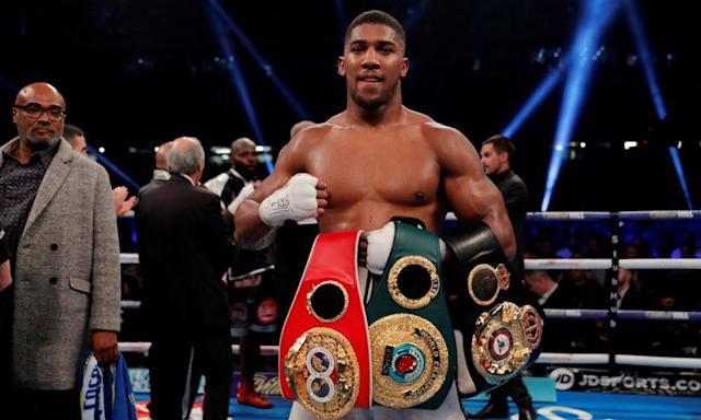 """<span class=""""element-image__caption"""">Anthony Joshua shows off his IBF and WBA heavyweight belts after beating Carlos Takam in Cardiff last month.</span> <span class=""""element-image__credit"""">Photograph: Andrew Couldridge/Action Images via Reuters</span>"""
