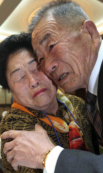 North Korean Lim Jong Soo, right, and his South Korean sister Lim Jong-suck get emotional as they reunite during the Separated Family Reunion Meeting at Diamond Mountain resort in North Korea, Sunday, Feb. 23, 2014. Elderly North and South Koreans separated for six decades are tearfully reuniting, grateful to embrace children, brothers, sisters and spouses they had thought they might never see again. (AP Photo/Yonhap, Lee Ji-eun) KOREA OUT