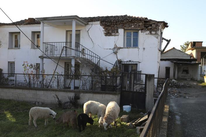 Damage is seen on a house after an earthquake in Mesochori village, central Greece, Wednesday, March 3, 2021. An earthquake with a preliminary magnitude of at least 6.0 struck central Greece Wednesday and was also felt in neighboring Albania and North Macedonia, and as far as Kosovo and Montenegro. (AP Photo/Vaggelis Kousioras)