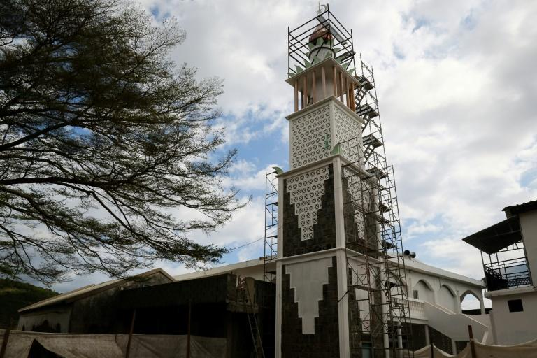 At France's oldest mosque, a half-century-old edifice on the overseas island territory of Mayotte, the sound of jackhammers is broken intermittently by the recitals of the faithful hunched over in prayer