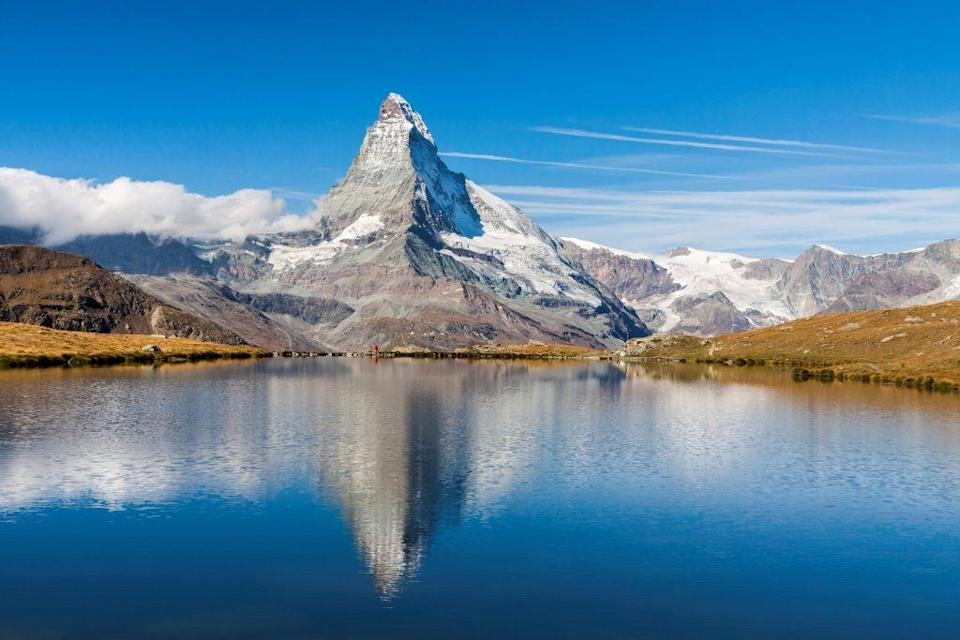 A clear summer morning at the foot of the Matterhorn. Zermatt. Canton of Valais. Switzerland. Europe. Photo by: Francesco Vaninetti/ClickAlps/REDA&CO/UIG via Getty Images