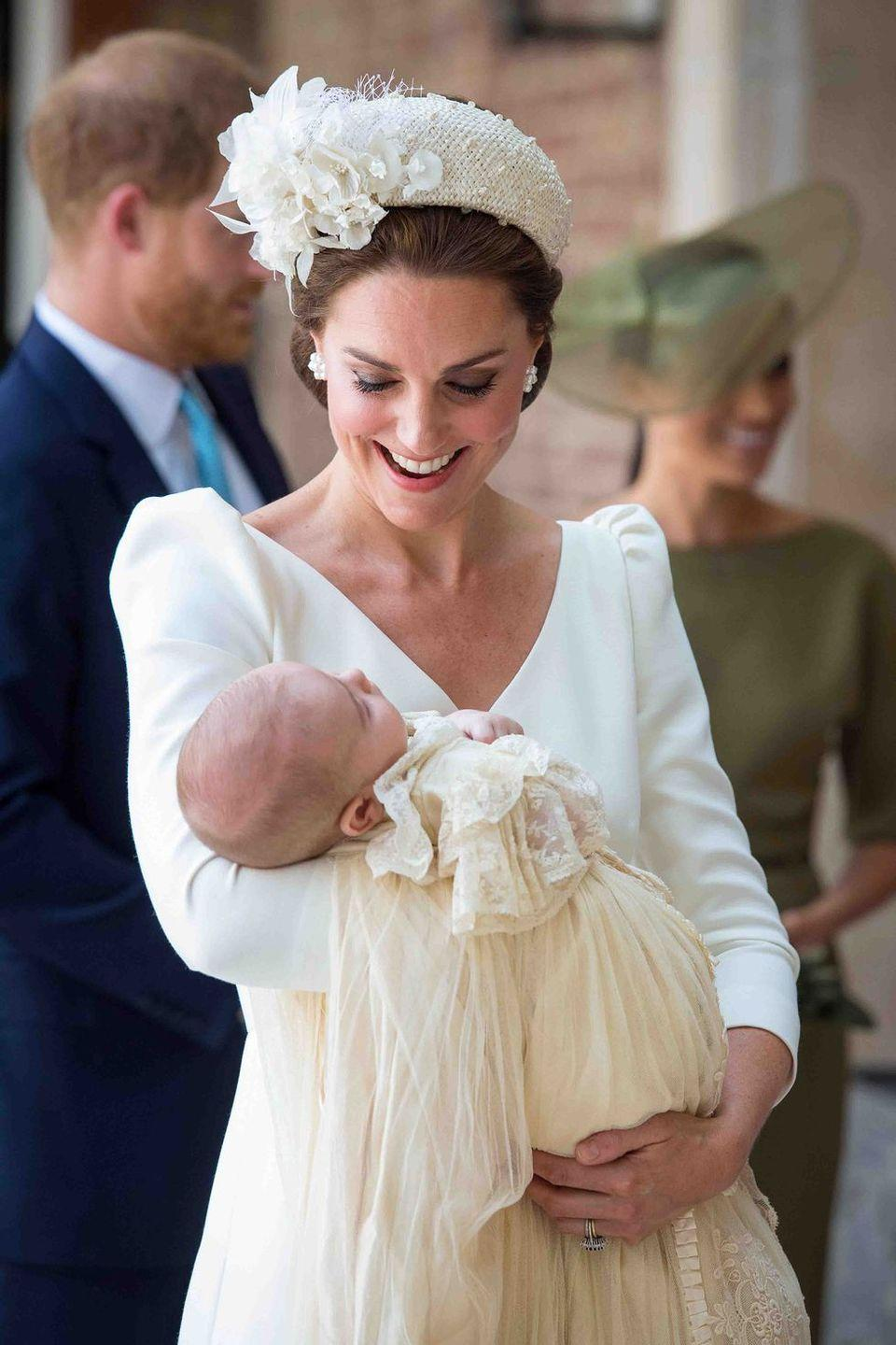 <p>Kate chose all-white Alexander McQueen for the christening of her third born, Prince Louis. She paired it with a statement headpiece by Jane Taylor.</p>