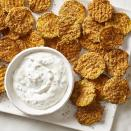 """<p>These crispy baked zucchini waffle fries with a ranch-style dipping sauce are a super-fun snack, appetizer or side dish. You can use all sorts of herbs in the creamy dipping sauce, including chives, dill, tarragon or parsley--or a combo. Pickle fans will love the sauce with dill, which pairs especially nicely with the Old Bay in the breadcrumb coating on the zucchini. To create the waffle shape, you can use a mandoline or special waffle cutter, such as the Borner Wave Waffle Cutter, which sells for about $25. This healthy fry recipe would also be delicious with regular sliced zucchini rounds if you'd rather not fuss with special equipment at all. <a href=""""http://www.eatingwell.com/recipe/276094/baked-zucchini-waffle-fries-with-creamy-herb-dip/"""" rel=""""nofollow noopener"""" target=""""_blank"""" data-ylk=""""slk:View recipe"""" class=""""link rapid-noclick-resp""""> View recipe </a></p>"""
