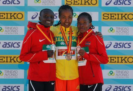 Athletics - IAAF World Half Marathon Championships - Valencia, Spain - March 24, 2018 Ethiopia's Netsanet Gudeta Kebede poses with the gold medal and Kenya's Joyciline Jepkosgei and Kenya's Pauline Kaveke Kamulu pose with their silver and bronze medals after the women's race REUTERS/Heino Kalis