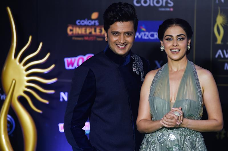 Ritesh Deshmukh with his wife, actress Genelia D'Souza. (Photo: PUNIT PARANJPE via Getty Images)