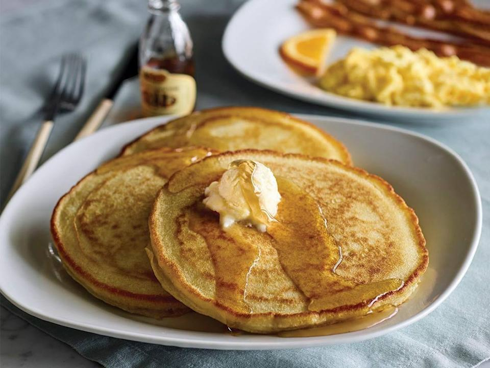 """<p>With the everlasting appeal of breakfast all day and how hard it can be to find, does any other dish on Cracker Barrel Old Country Store's menu even have a chance against <a href=""""https://crackerbarrel.com/menu/breakfast/pancakes-and-such/mommas-pancake-breakfast"""" rel=""""nofollow noopener"""" target=""""_blank"""" data-ylk=""""slk:Momma's Pancake Breakfast"""" class=""""link rapid-noclick-resp"""">Momma's Pancake Breakfast</a>? Sure, the biscuits are renowned and the mac & cheese is beloved, but the most popular entree is this balanced breakfast. Golden pancakes you can drown in syrup and butter flanked by eggs and sausage or bacon. It just doesn't get any more classic than that.</p>"""