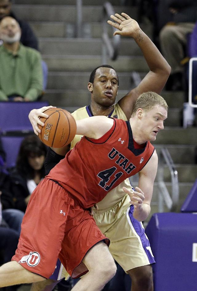 Utah's Jeremy Olsen (41) tries to drive past Washington's Perris Blackwell during the first half of an NCAA college basketball game Wednesday, Jan. 8, 2014, in Seattle. (AP Photo/Elaine Thompson)
