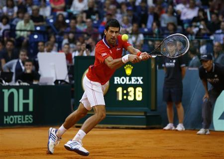Serbia's Djokovic returns the ball to Canada's Pospisil during their Davis Cup semi-final tennis match in Belgrade