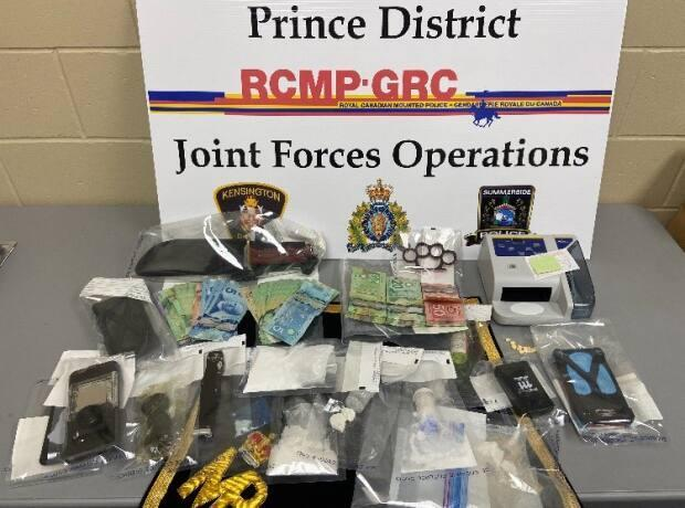 Drugs, cash and weapons seized by police in Summerside Thursday. (RCMP - image credit)