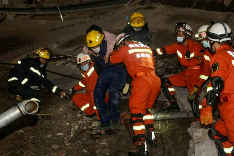 Footage circulating on Twitter-like Weibo showed rescue workers combing through the rubble of the 80-room Xinjia hotel (AFP Photo/STR)
