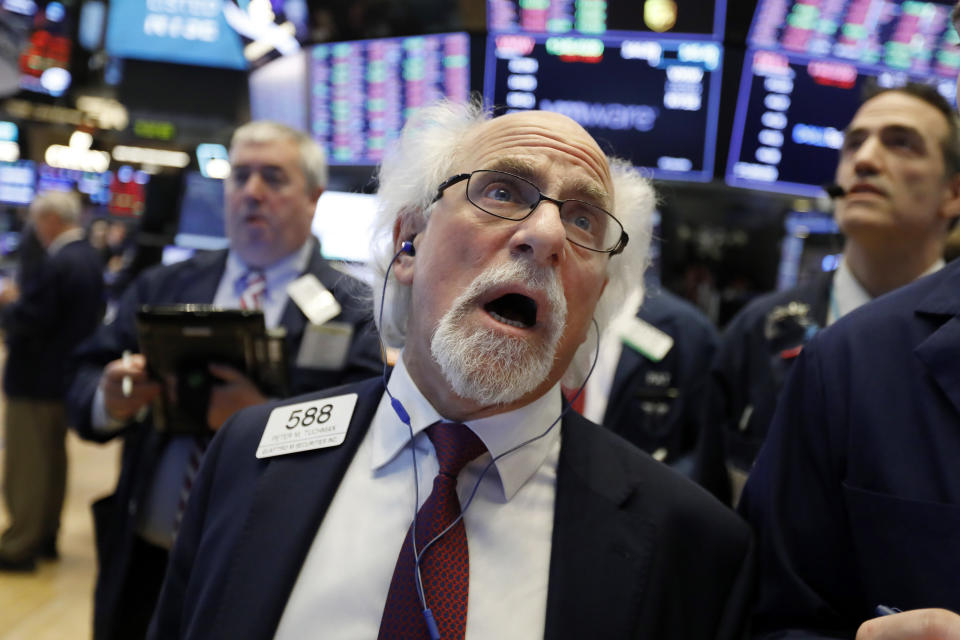 Trader Peter Tuchman works on the floor of the New York Stock Exchange, Monday, Jan. 14, 2019. Stocks are opening lower on Wall Street after China reported a surprise drop in exports to the U.S. last month. (AP Photo/Richard Drew)