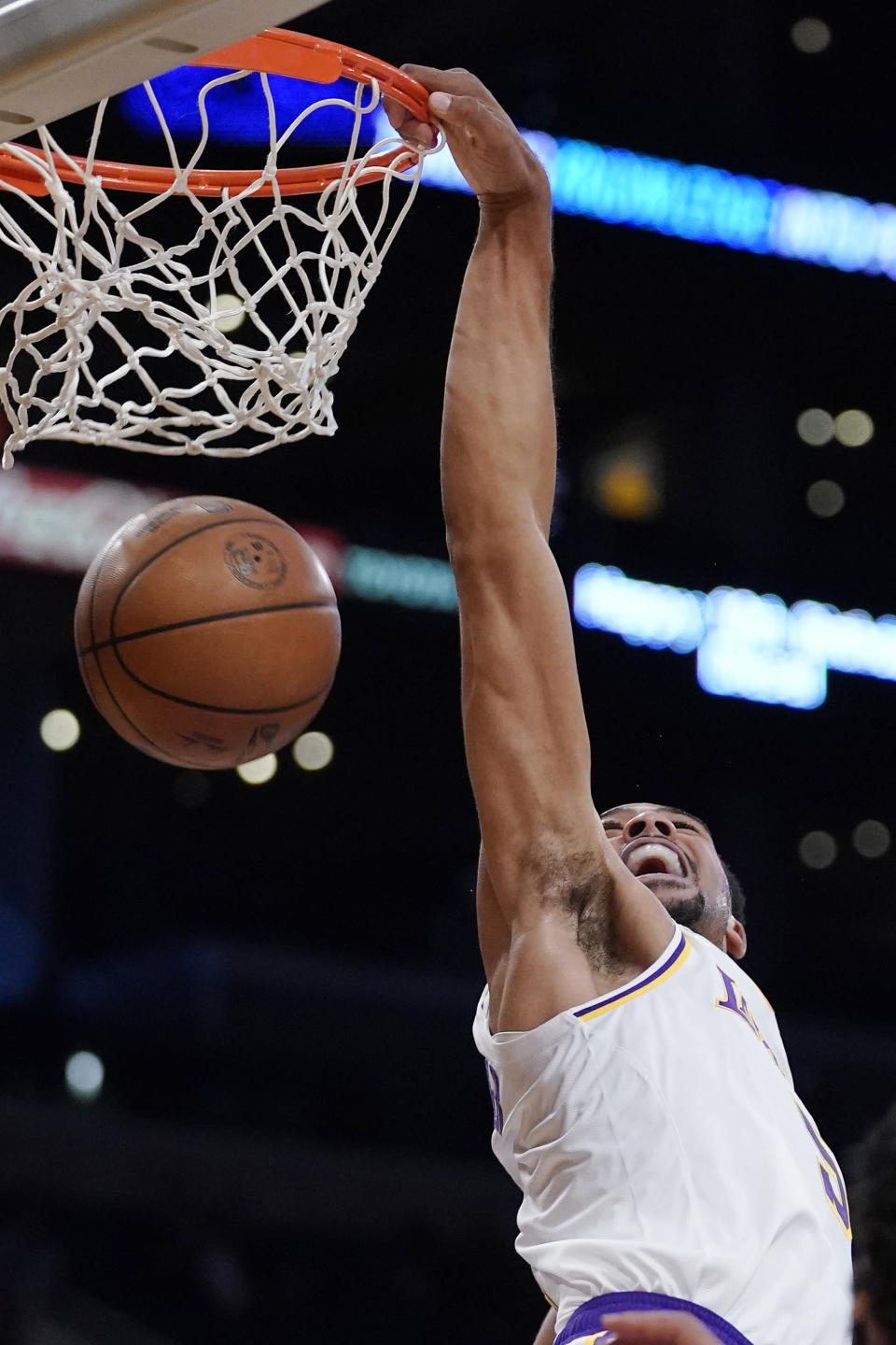 Los Angeles Lakers guard Talen Horton-Tucker dunks during the first half of a preseason NBA basketball game against the Brooklyn Nets Sunday, Oct. 3, 2021, in Los Angeles. (AP Photo/Mark J. Terrill)