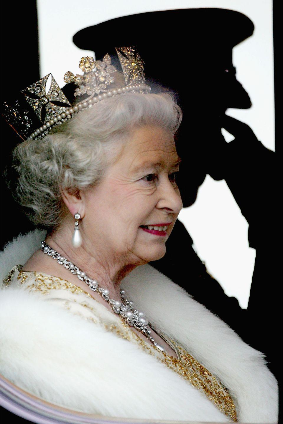 <p>The queen looked out the window as she rode in a carriage to the opening of Parliament in London.</p>