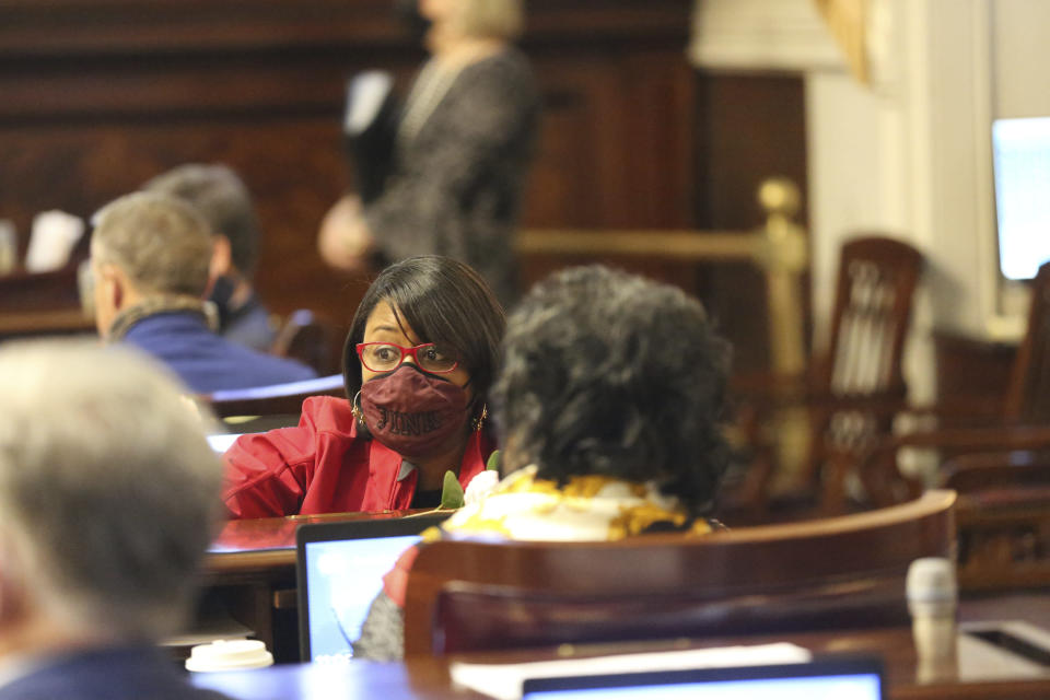 State Rep. Krystle Matthews, D-Ladson, speaks to fellow lawmakers on Wednesday, March 3, 2021, in Columbia, S.C. Matthews said many of her colleagues don't listen to Black lawmakers when they call for diversity in the state's judges and college and university trustees. (AP Photo/Jeffrey Collins)