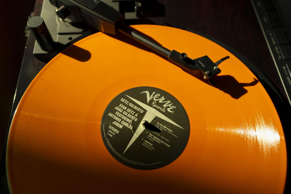 A vinyl record by The Verve plays on a turntable, Thursday, May 27, 2021, in Falmouth, Maine. The COVID-19 pandemic benefitted record store owners who saw a surge in sales. That's good news for the indie record stores ahead of Record Store Day on Saturday, June 12. (AP Photo/Robert F. Bukaty)