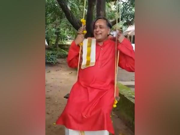 Congress leader Shashi Tharoor playing on the swing