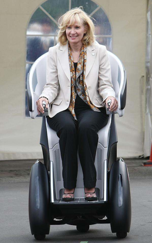 RUSUTSU, JAPAN - JULY 08:  Laureen Harper, wife of Canadian Prime Minister Stephen Harper tries out Toyota Motor Corporation's Personal Mobility i-REAL during a concept car trial ride event upon their visit to the International Media Center at Rusutsu Resort on July 8, 2008 in Rusutsu, Hokkaido, Japan. During this 3-day Summit meeting, leaders from the eight strong industrial countries discuss on issues such as world economy, environment and climate changes and development in Africa.  (Photo by Junko Kimura/Getty Images)