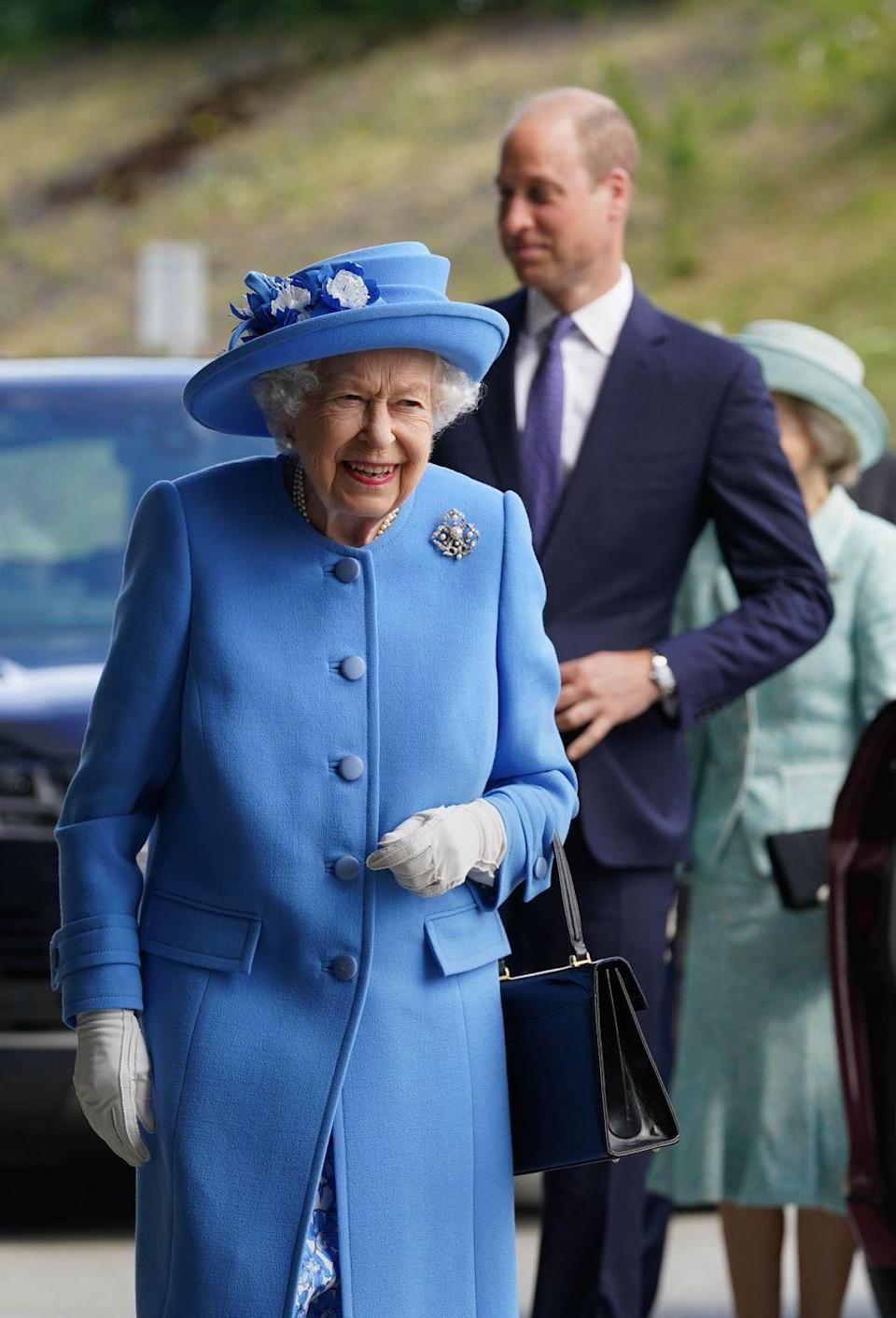 <p>The queen and Prince William arrive at AG Barr's factory, the manufacturing center of the Irn-Bru drink, in Cumbernauld, Scotland, on June 28, 2021.</p>