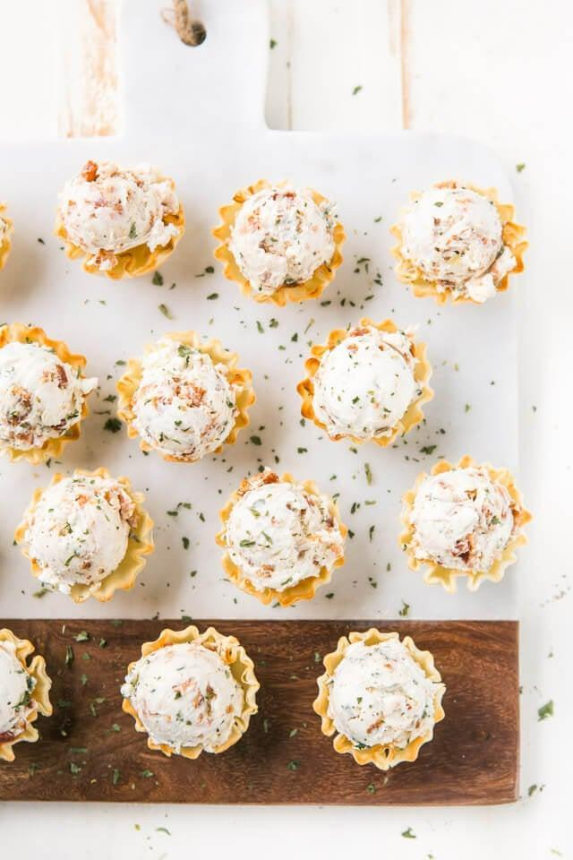 """<p>If you need an easy and quick app, you can't go wrong with these phyllo bites. They only take 20 minutes to whip up, and the results are drool-worthy.</p> <p><strong>Get the recipe:</strong> <a href=""""https://www.azestybite.com/honey-bacon-goat-cheese-phyllo-bites/"""" class=""""link rapid-noclick-resp"""" rel=""""nofollow noopener"""" target=""""_blank"""" data-ylk=""""slk:honey bacon goat cheese phyllo bites"""">honey bacon goat cheese phyllo bites</a></p>"""