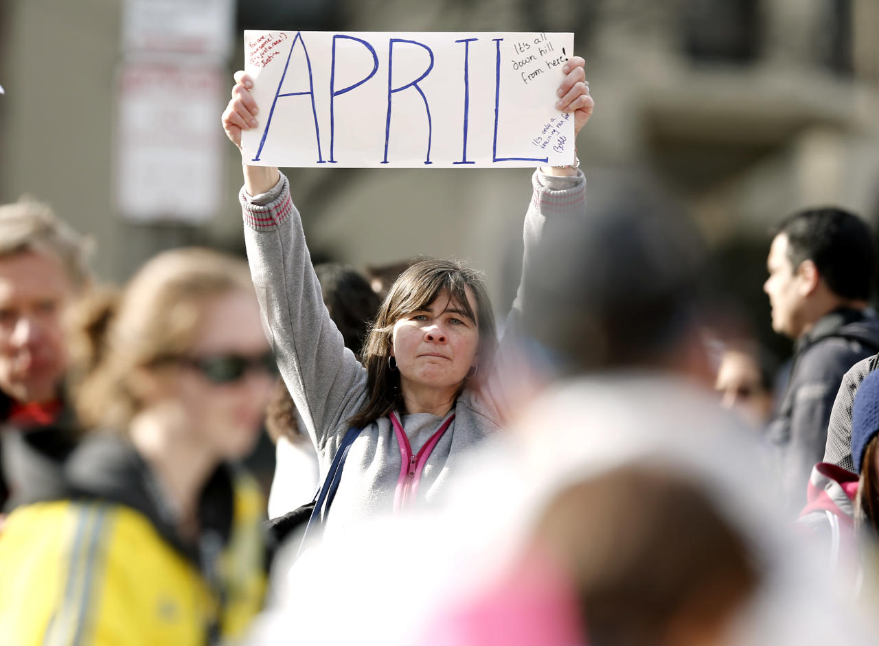 <p> Justine Franco of Montpelier, Vt., holds up a sign near Copley Square in Boston looking for her missing friend, April, who was running in her first Boston Marathon Monday, April 15, 2013. Two bombs exploded near the finish line of the marathon on Monday, killing at least two people and injuring at least 23 others. (AP Photo/Winslow Townson)