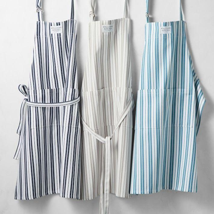 """<p><strong>Williams-Sonoma</strong></p><p>williams-sonoma.com</p><p><strong>$29.95</strong></p><p><a href=""""https://go.redirectingat.com?id=74968X1596630&url=https%3A%2F%2Fwww.williams-sonoma.com%2Fproducts%2Fpersonalized-stripe-apron%2F&sref=https%3A%2F%2Fwww.countryliving.com%2Fshopping%2Fgifts%2Fg34500004%2Fmonogram-gift-ideas%2F"""" rel=""""nofollow noopener"""" target=""""_blank"""" data-ylk=""""slk:Shop Now"""" class=""""link rapid-noclick-resp"""">Shop Now</a></p><p>A kitchen essential, your home chef will love this 100% cotton striped apron with roomy double front pockets. Add a monogram to make it truly their own.</p>"""