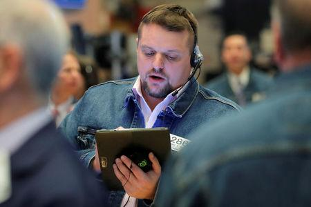 Traders wear Levi's clothing during Levi Strauss & Co. IPO on floor of New York Stock Exchange (NYSE) in New York
