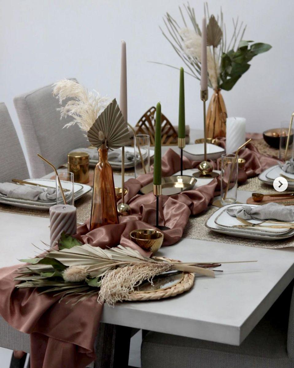 """<p>Dried flowers are beautiful and affordable and, best of all, they can be reused in the future for a tablescape that evolves with you every year. Blogger Neelam of <a href=""""https://www.instagram.com/p/CM_rGWSnSuT/"""" rel=""""nofollow noopener"""" target=""""_blank"""" data-ylk=""""slk:Home of Gold"""" class=""""link rapid-noclick-resp"""">Home of Gold</a> styled hers with pampas and palm leaf, the perfect neutrals to let the muted color palette shine.</p>"""