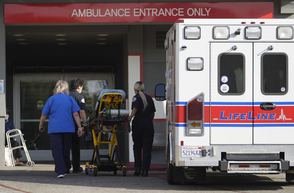 FILE - In this Jan. 5, 2021 file photo a LifeLine Ambulance arrives at the CHA Hollywood Presbyterian Medical Center (CHA HPMC) in Los Angeles. California health authorities reported on Saturday, Jan. 9, 2021, a record high of 695 coronavirus deaths as many hospitals strain under unprecedented caseloads. The state Department of Public Health says the number raises the state's death toll since the start of the pandemic to 29,233. (AP Photo/Damian Dovarganes, File)