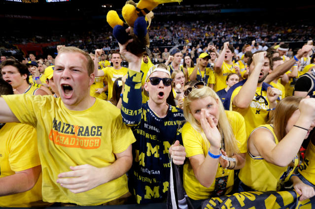 Michigan fans cheer before the championship game against Villanova in the Final Four NCAA college basketball tournament, Monday, April 2, 2018, in San Antonio. (AP Photo/Eric Gay)
