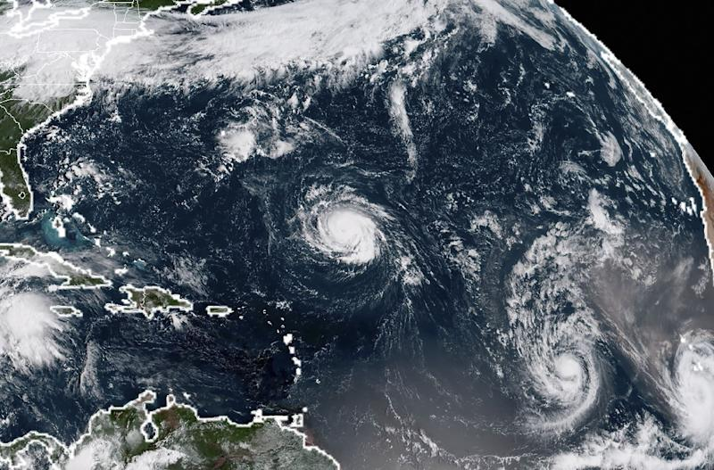 This NOAA/RAMMB satellite image taken at 13:30 UTC on September 9, 2018 shows Tropical Storm Florence -- which forecasters say will soon become an extremely dangerous hurricane -- being followed westward across the Atlantic by Tropical Storms Isaac and Helene8. (AFP Photo/HO)
