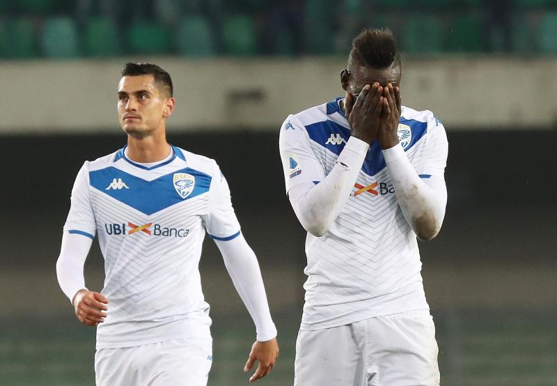 Brescia's Mario Balotelli, right, reacts at the end of the Italian Serie A soccer match between Verona and Brescia at the Bentegodi stadium in Verona, Italy, Sunday, Nov. 3, 2019. Verona supporters' racist chants upset the Italian bomber who also scored one goal. (Simone Venezia/ANSA via AP)