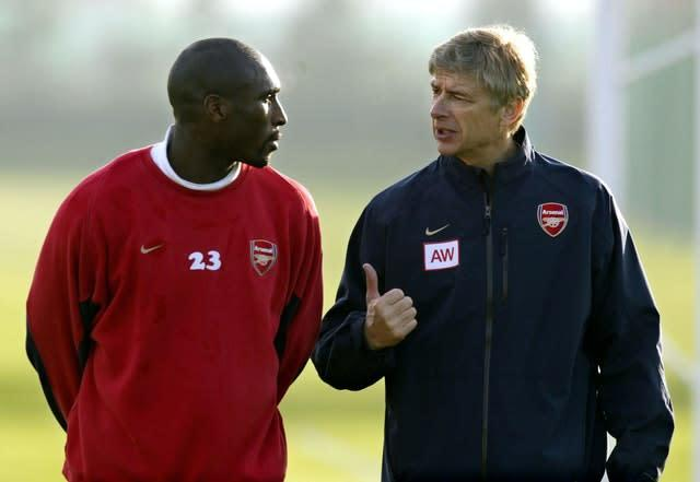 Arsene Wenger with Sol Campbell (PA)