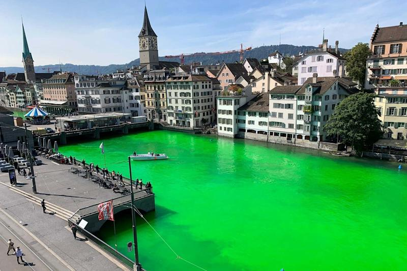 Extinction Rebellion activists said they dyed the Limmat River green to highlight the dangers of global warming: VIA REUTERS