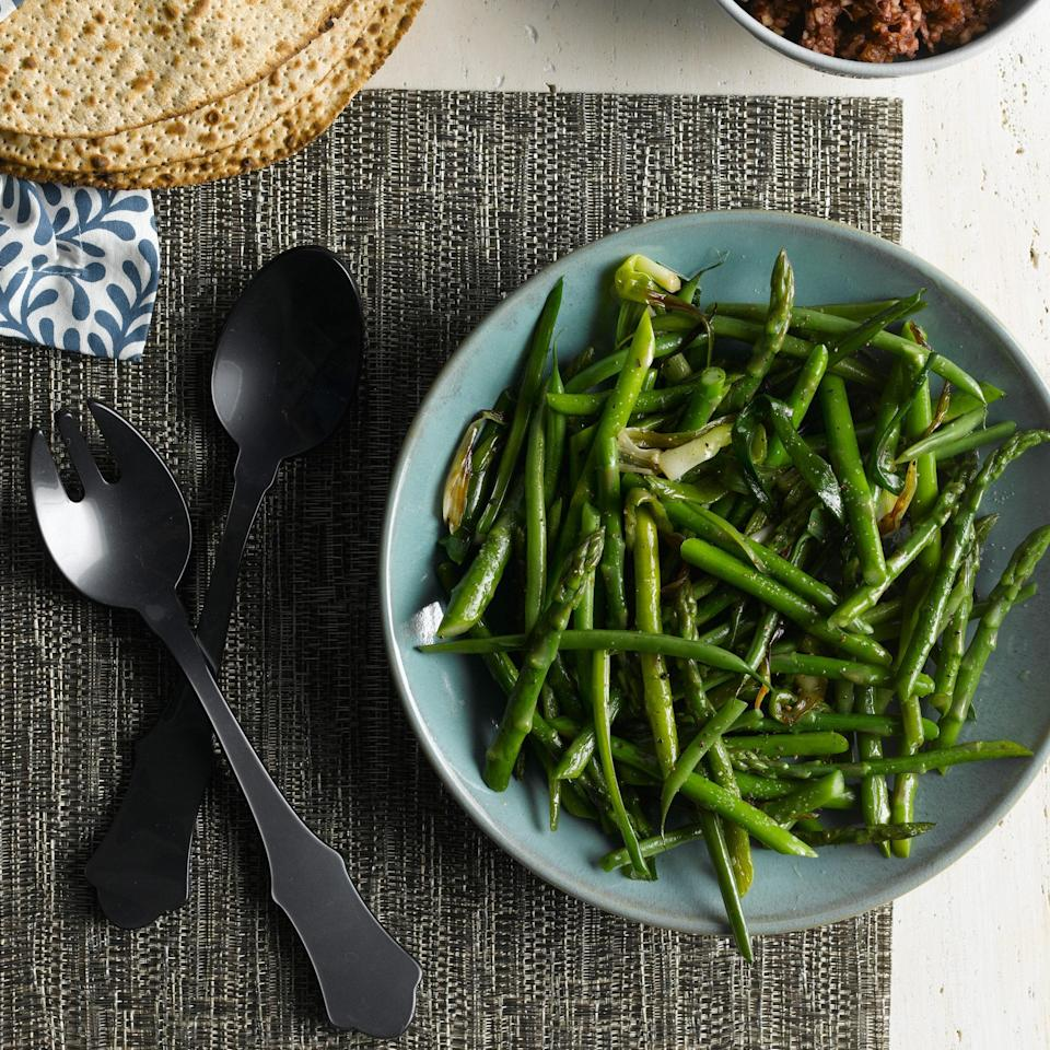 "Beans aren't the only green player in this recipe: Blanched until just tender, they share a plate with crisp <a href=""https://www.epicurious.com/ingredients/all-about-asparagus-recipes-gallery?mbid=synd_yahoo_rss"" rel=""nofollow noopener"" target=""_blank"" data-ylk=""slk:asparagus"" class=""link rapid-noclick-resp"">asparagus</a> and savory sautéed green onions. <a href=""https://www.epicurious.com/recipes/food/views/asparagus-green-onion-saute-394989?mbid=synd_yahoo_rss"" rel=""nofollow noopener"" target=""_blank"" data-ylk=""slk:See recipe."" class=""link rapid-noclick-resp"">See recipe.</a>"