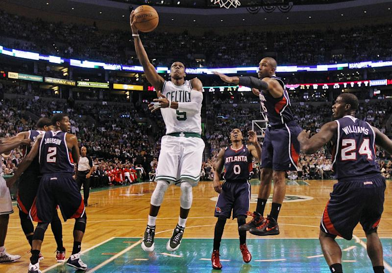 Boston Celtics point guard Rajon Rondo (9) drives past Atlanta Hawks shooting guard Joe Johnson (2), guard Jeff Teague (0), center Al Horford and forward Marvin Williams (24) during the first quarter of Game 6 in a first-round NBA basketball playoff series in Boston, Thursday, May 10, 2012. (AP Photo/Charles Krupa)