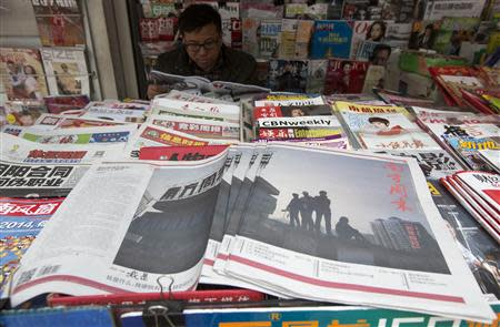 Southern Weekly newspaper copies are left on display at a newsstand in the southern Chinese city of Guangzhou January 7, 2014. REUTERS/Tyrone Siu