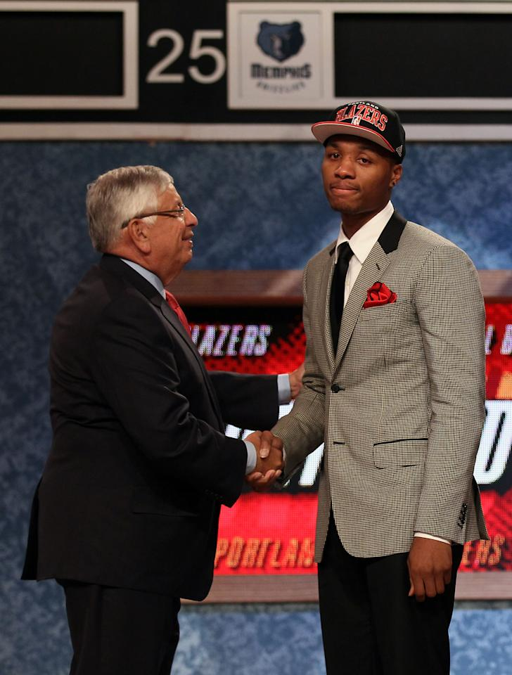 NEWARK, NJ - JUNE 28:  Damian Lillard (R) of Weber State greets NBA Commissioner David Stern (L) after he was selected number six overall by the Portland Trail Blazers during the first round of the 2012 NBA Draft at Prudential Center on June 28, 2012 in Newark, New Jersey. NOTE TO USER: User expressly acknowledges and agrees that, by downloading and/or using this Photograph, user is consenting to the terms and conditions of the Getty Images License Agreement.  (Photo by Elsa/Getty Images)